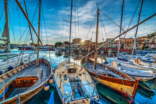 Aluminium Prints Port Wooden boats in La Maddalena harbor at sunset