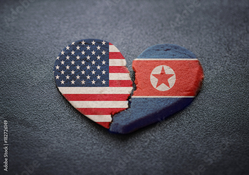 American and North Korea flags breaking heart symbol. Canvas Print