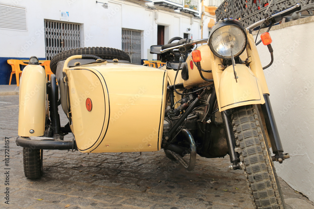 Fototapeta Old motorcycle with sidecar of the seventies
