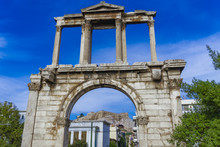 Athens, Greece Hadrian's Arch Day View. Ancient Marble Gateway With Corinthian Columns And Background View Of Athens Acropolis.
