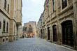 View at Maiden Tower in down town of Baku. Kichik Qala street. Walking on empty, morning street in old town of Baku city.