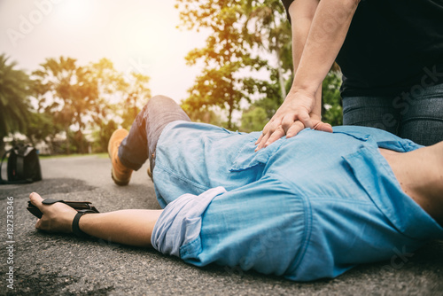 Photo First Aid Emergency CPR on a Man who has Heart Attack or Shock , One Part of the