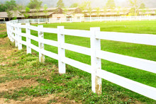 White Concrete Fence In Farm Field With Sunlight
