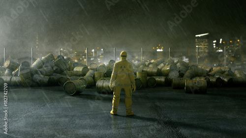 Fotografie, Obraz  Arbeiter steht vor Fässern mit Atommüll