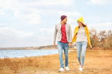 Young Couple Walking Near Rive...