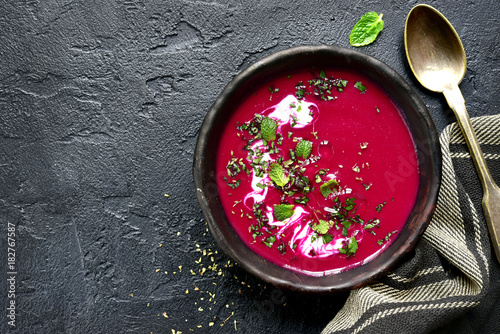 Beetroot creamy soup.Top view with copy space.