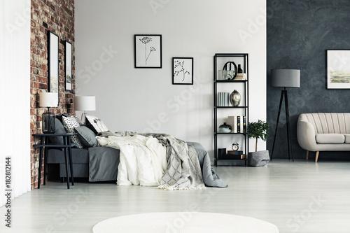 Staande foto Hoogte schaal Spacious bright bedroom with drawings