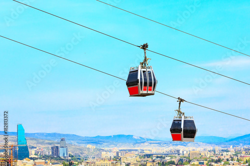 Obraz Tbilisi, Georgia funicular cabins and aerial city skyline panoramic view - fototapety do salonu