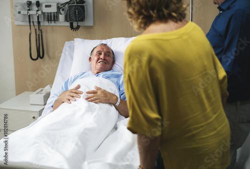 Fotografie, Obraz  Friends visiting sick man at a hospital