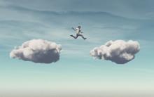 Businessman Jumps On A Cloud