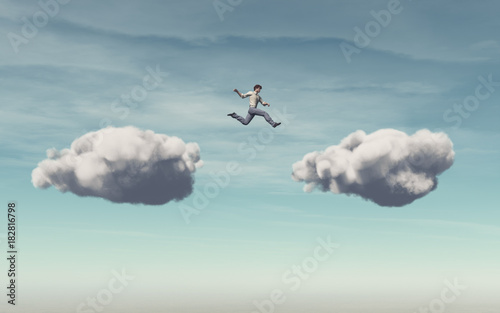 Photo Businessman jumps on a cloud