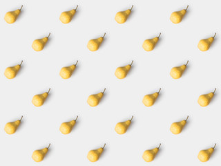 pattern of delicious yellow pears isolated on white