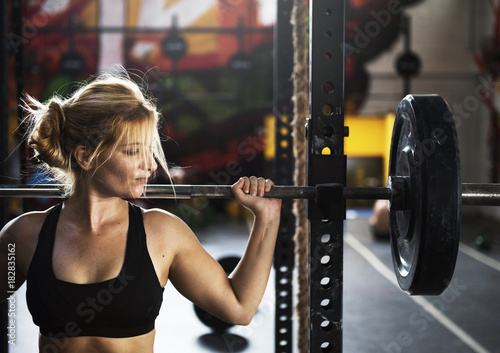Foto op Canvas Fitness Strong woman at the gym