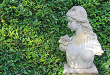 Woman Statue In The Garden With Copy Space.