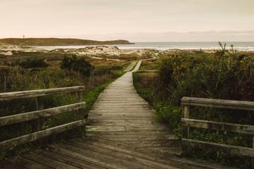 Fototapeta Wooden promenade in Frouxeira beach