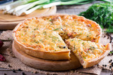 A piece of French quiche Lorraine on wooden background - 182841953