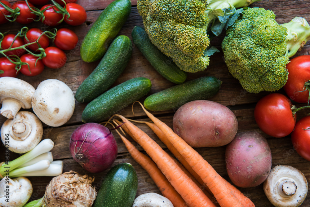 Fresh vegetables  on the wood plate