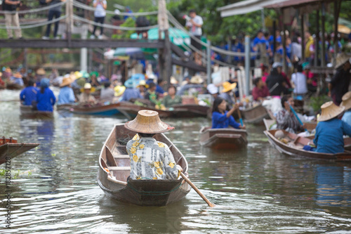 old lady boating to trade food in floating market
