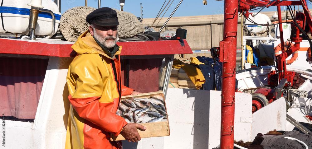 Fototapety, obrazy: fisherman with a fish box inside a fishing boat