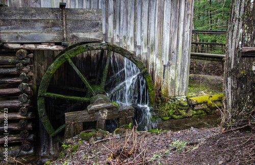 Aluminium Prints Mills Vintage Wooden Water Wheel. Historic pioneer wooden waterwheel with water flowing over it. Great Smoky Mountains National Park. Gatlinburg, Tennessee.