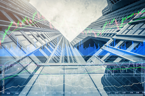 Stampa su Tela double exposure with modern building and financial market stock chart business i