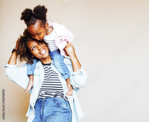 Valokuvatapetti adorable sweet young afro-american mother with cute little daugh