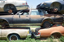 Stack Of Old Rusting Cars In A Breakers Yard