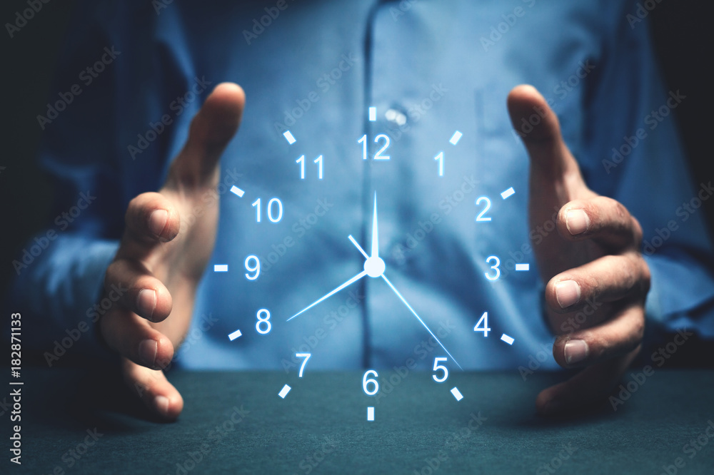 Businessman showing clock. Concept of saving time.