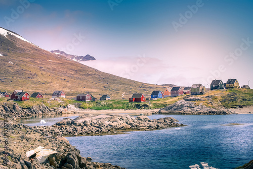 Poster Poolcirkel Greenland : bay with an inuit village, colored houses bay with an inuit village