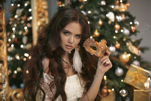 happy new year background by victoria andreas christmas beautiful smiling woman with carnival mask fashion earring makeup healthy long