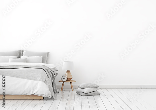 Photo  Home interior wall mock up with unmade bed, plaid,cushions and lamp in white bedroom
