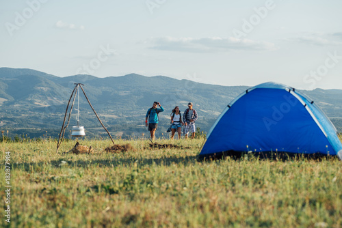 Canvas Prints Camping Group of friends explore mountain