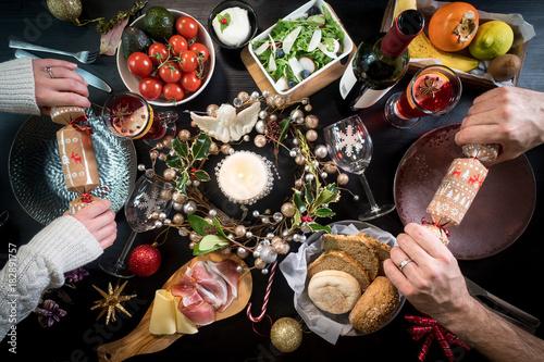Foto op Canvas Kruidenierswinkel festive christmas table food hands celebration drink