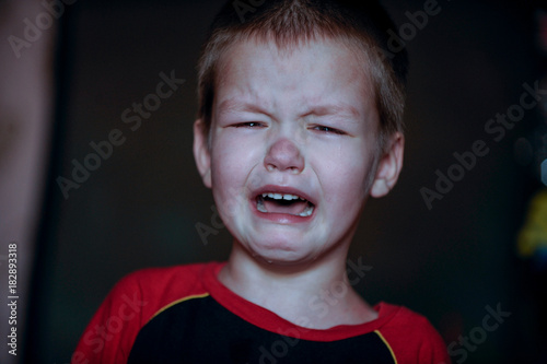 Fényképezés  Caucasian white little boy crying with tears portrait outdoor.