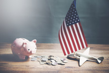 Piggy Bank, American Flag And Airplane