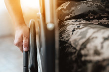 Woman Veteran In Wheelchair Returned From Army. Close-up Photo Veteran Woman In A Wheelchair.