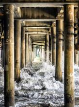 Waves Crashing The Pillars Under The Santa Monica Pier - Santa Monica, Los Angeles, LA, California, CA, USA