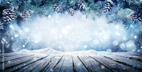 Fotobehang Wit Winter Display - Fir Branches On Snowy Table