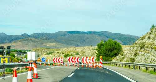Fotobehang Lichtblauw Fast road in the mountains in Spain, beautiful landscape of mountains, dry earth and rock from the sun
