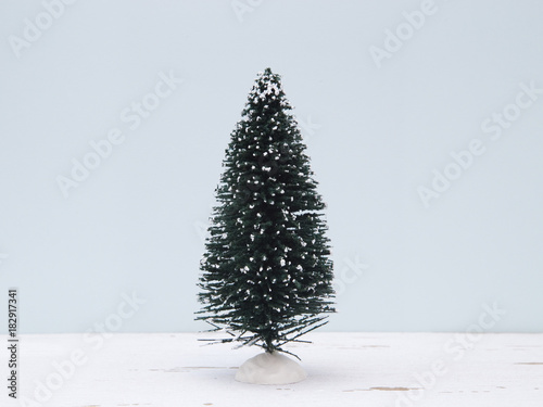 Minimalistic Christmas Scene with a Blue Background on a Distressed Wooden Table Wallpaper Mural