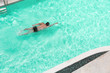 Man is swimming in pool at resort.from top view