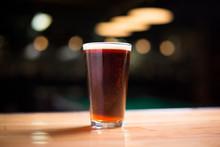 Pint Of A Dark Ale On A Wood C...