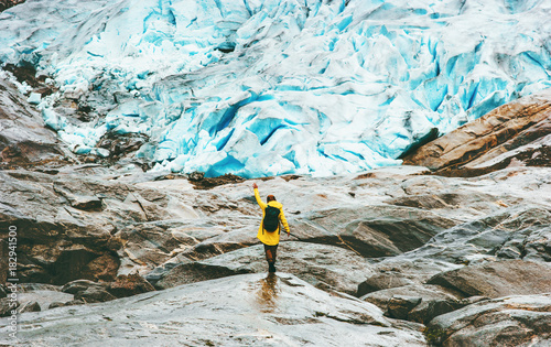 Obraz Woman hiking at Nigardsbreen glacier  Travel Lifestyle ecology concept adventure vacations outdoor nature in Norway - fototapety do salonu