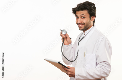 Young doctor showing stethoscope Wallpaper Mural