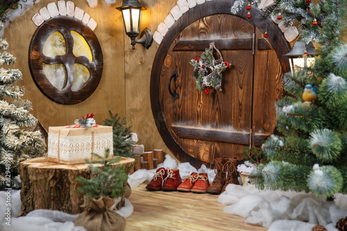 doors to the hobbit gnome house with Christmas decorations and shoes Wallpaper Mural