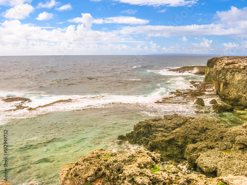 Fotobehang Caraïben Panorama of cliffs and wild coastal stretch of Grande-Terre in Guadeloupe island, French Caribbean and French Antilles. Summer season.