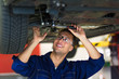 Car mechanic in workshop
