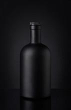 Black Whiskey Bottle On Dark Background