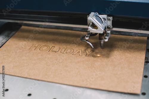 Fototapeta Industrial laser engraving word
