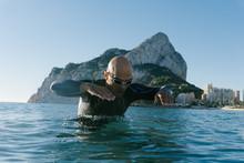 Swimmer In Blue Ocean Water